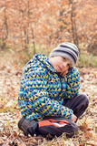 Child in autumn forest Royalty Free Stock Photo