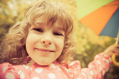 Child in autumn Stock Photos
