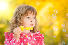 Child in autumn Stock Images