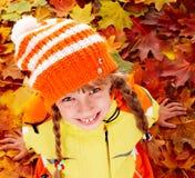 Child in autumn orange leaves. Stock Image
