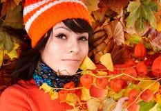 Child in autumn orange leaves. Little girl in autumn orange leaves. Outdoor royalty free stock photography