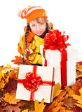 Child in autumn orange leaves. Royalty Free Stock Images