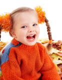 Child in autumn orange leaves. Stock Image