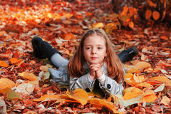 Child in autumn park Royalty Free Stock Images
