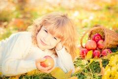 Child in autumn park Royalty Free Stock Photos