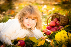 Child in autumn park Royalty Free Stock Photo