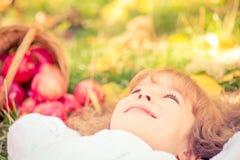 Child in autumn park Stock Image