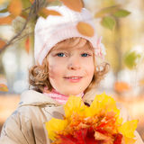 Child in autumn park Stock Photos