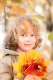 Child in autumn park Stock Photo