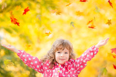 Child in autumn park Royalty Free Stock Photos