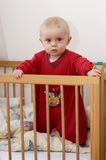 Child in Baby Bed Royalty Free Stock Images