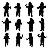 Child with baby bottle vector in black Royalty Free Stock Photos
