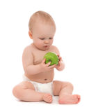 Child baby boy sitting with green apple Stock Images