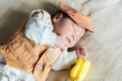 Child baby boy with tulip. Mothers day Royalty Free Stock Photography