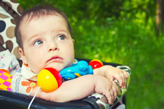 Child in a baby carriage Stock Photography