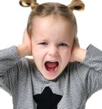 Child baby girl happy yelling screaming with hands closing ears Royalty Free Stock Photography