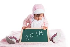Child baby girl holding wooden blackboard  with text 2018 year i. Solated on white Stock Photo