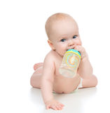 Child baby girl lying happy holding breastfeeding bottle nipple Royalty Free Stock Photos