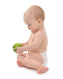 Child baby girl toddler sitting eating green apple Stock Photography