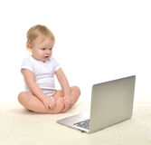 Child baby girl toddler sitting with modern wireless computer la Royalty Free Stock Photos