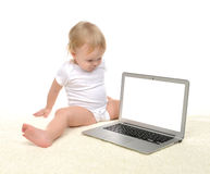 Child baby girl toddler sitting near modern wireless computer la Stock Images