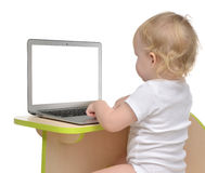 Child baby girl toddler typing on modern computer laptop keyboar Royalty Free Stock Images