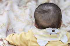 Child baby kid girl with a cute collar in the form of bears Royalty Free Stock Photo