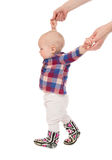 Child baby kid make first steps. Young mother hands helping her daughter child baby kid make first steps isolated on a white background Royalty Free Stock Photo