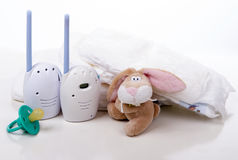 Child baby kid radio monitor device stack. Of diapers with baby feeding bottle water on a white background royalty free stock photo
