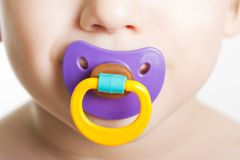 Child with baby pacifier stock photos