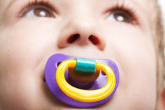 Child with baby pacifier royalty free stock image