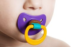 Child with baby pacifier Royalty Free Stock Photos