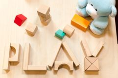 Child or baby play set, toy wooden blocks, teddy bear. Kindergarten or preschool background royalty free stock image