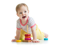 Child baby playing with color pyramid toy Royalty Free Stock Images