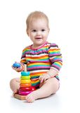 Child baby playing with color pyramid toy Royalty Free Stock Photos