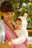 Child in a baby sling Royalty Free Stock Photos
