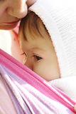 Child in a baby sling Royalty Free Stock Photography