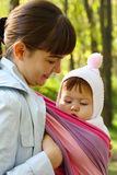 Child in a baby sling. Walk with the child in a baby sling Royalty Free Stock Photos