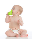 Child baby toddler sitting and playing wooden educational toy wi Royalty Free Stock Photo