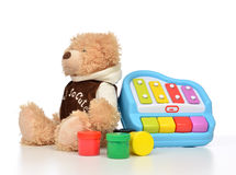 Child baby toys collage with colorfull paints, teddy bear xyloph Stock Photos