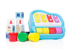 Child baby toys collage paint bricks with letters xylophone Stock Photos
