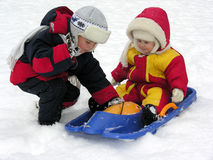 Child and baby. winter 2. Child and baby on sled. winter 2 Royalty Free Stock Image