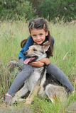 Child and baby wolf Stock Photo