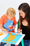 Child and Babysitter. Babysitter and boy glue pieces of paper Stock Images