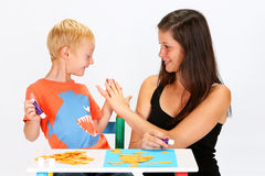 Child and Babysitter Royalty Free Stock Images