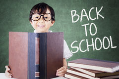 Child back to school and read books on desk Stock Photos