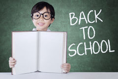 Child back to school and show empty book royalty free stock images