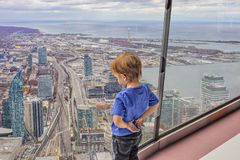 View of Toronto Downtown little boy looks down on the city