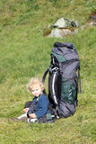 Child and backpack Stock Images