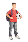 Child with backpack holding a ball Royalty Free Stock Image